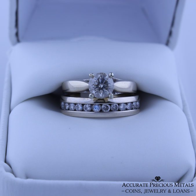 14 Karat White Gold Ring With .75 Carat Diamond Center Stone And Accent Diamonds